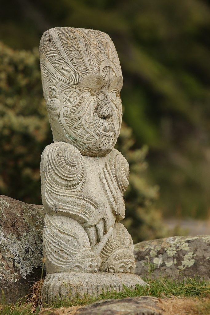 Stone carved maori grave site guardian coastal raglan new