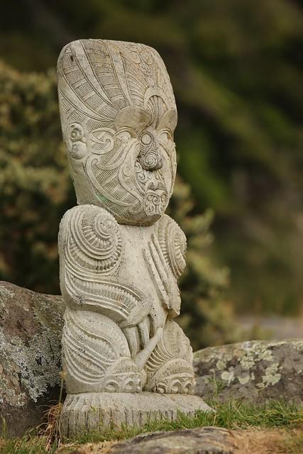 Stone carved maori grave site guardian coastal raglan new