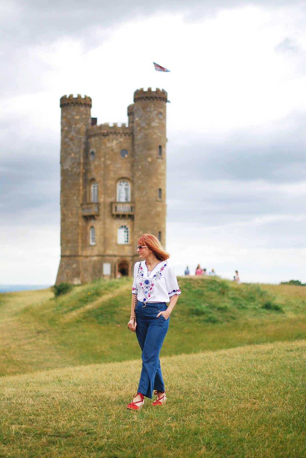 Embroidery and denim: Greek-style embroidered top, wide leg jeans, red lace-up espadrilles   Broadway Tower, The Cotswolds   Not Dressed As Lamb