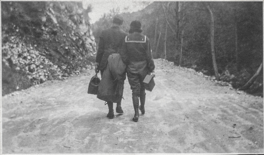Couple walking away on a dirt road | Undated ...