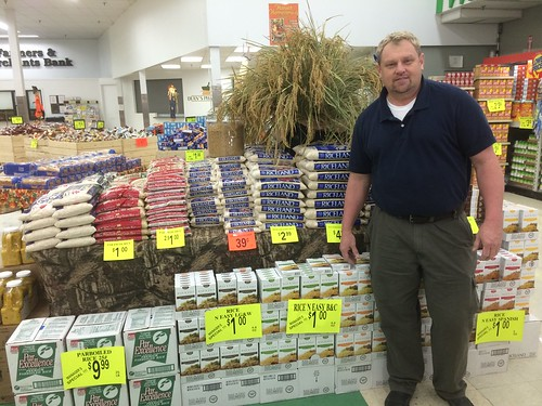 Glenn Buffkin, store manager of Mayflower Foods with a special display of rice products