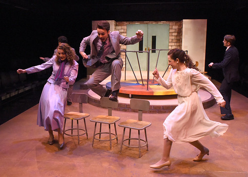 "The cast of ""Is There Life After High School?"" is shown jumping over chairs and stomping on the stage."