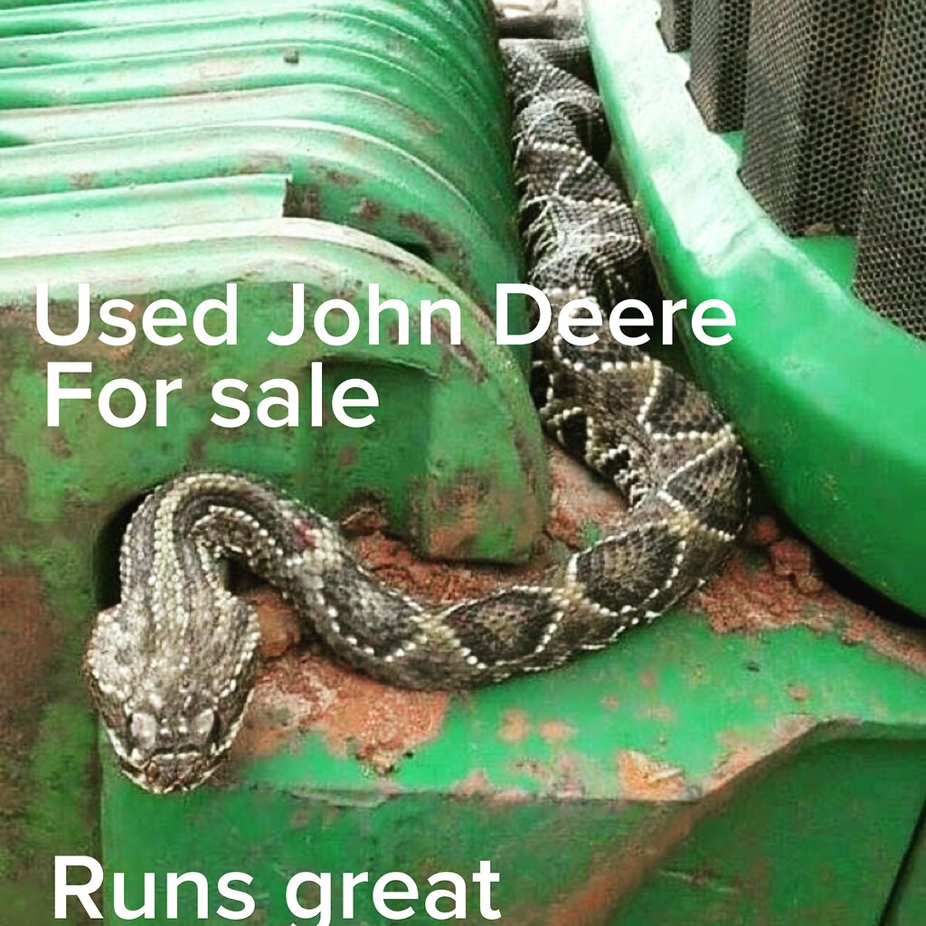 Vintage John Deere tractor with rattlesnake | Old rusty ...
