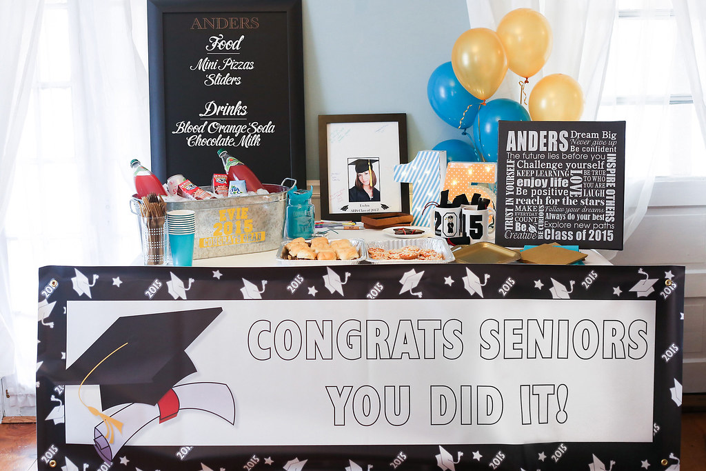graduation party table with steel tub full of drinks decorative personalized frame snacks burger sliders