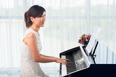 woman practicing piano