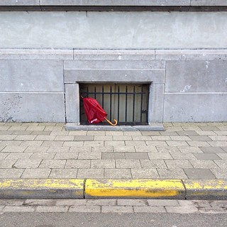 Where is spring? #springlooksbadlatelyanyway #umbrella #antwerpen #street #hide #p3top | by ana ventura
