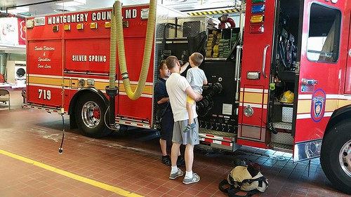 photos of father and child visiting fire station 19 in silver spring