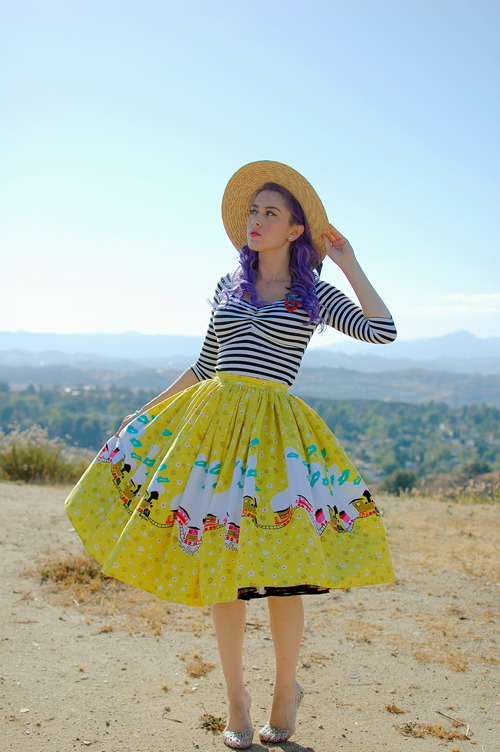Pinup Girl Clothing Jenny skirt in Mary Blair Train Border print