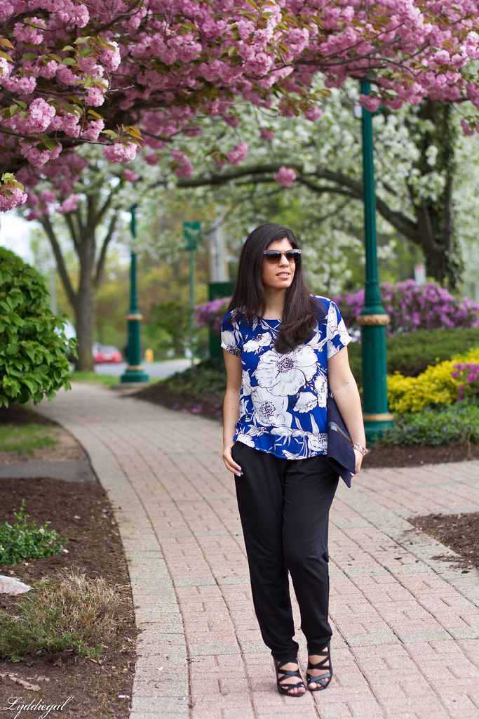 floral blouse, joggers, navy foldover clutch-1.jpg