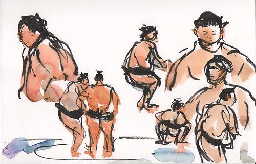Sumo wrestlers drawn from TV in Japan