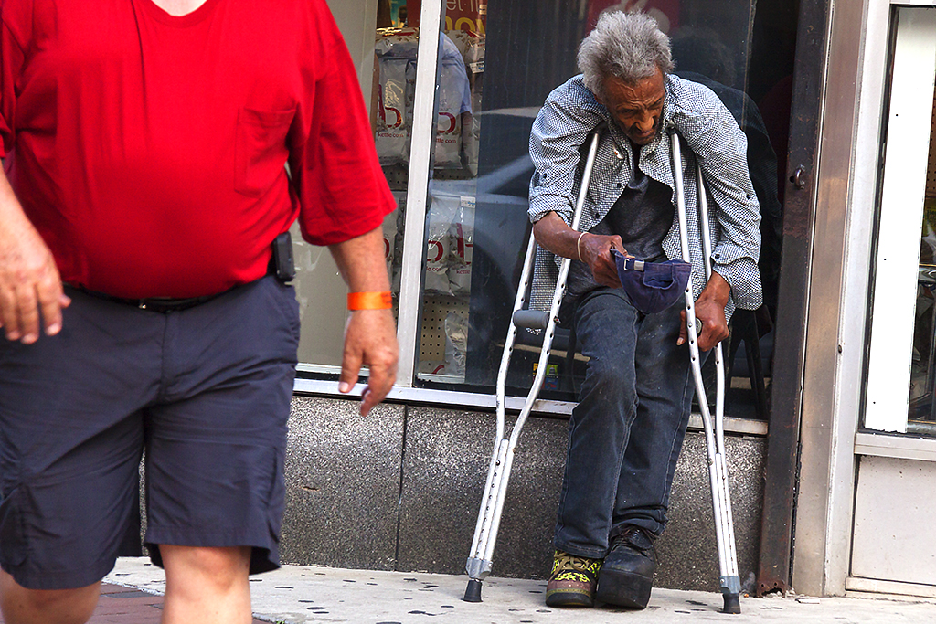 Old beggar with crutches on 7-10-16--Center City