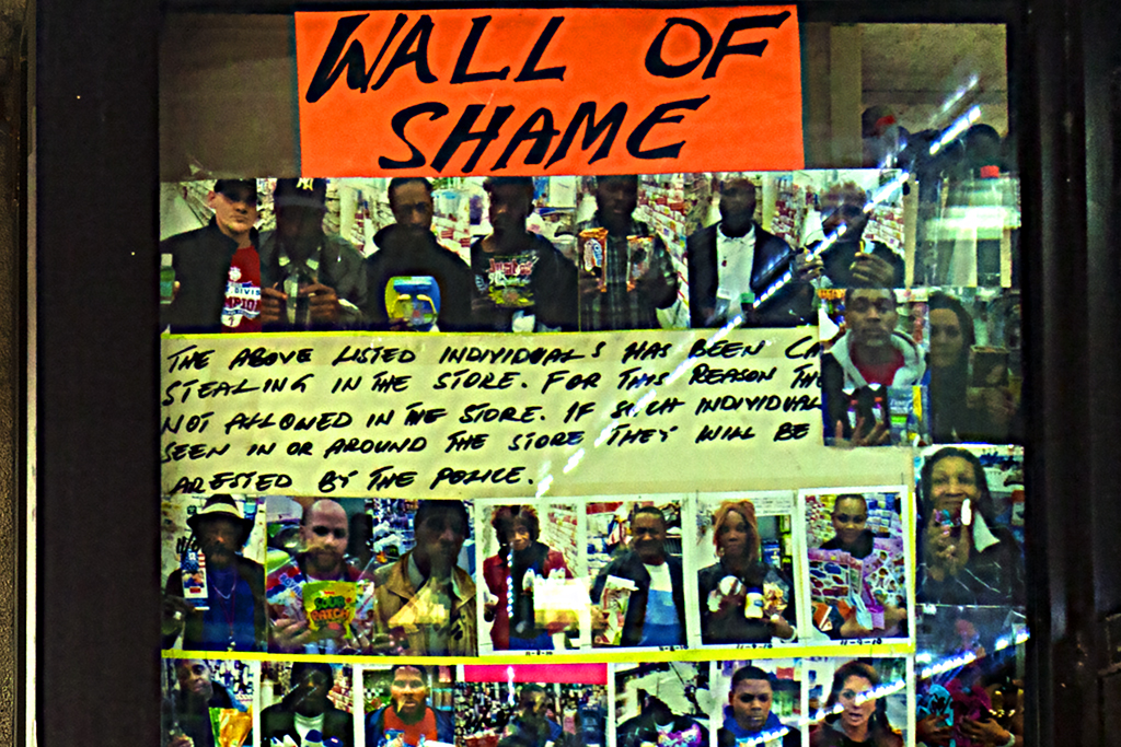 WALL-OF-SHAME-at-Dollar-store-at-12th-and-Chesnut--Center-City-(detail)
