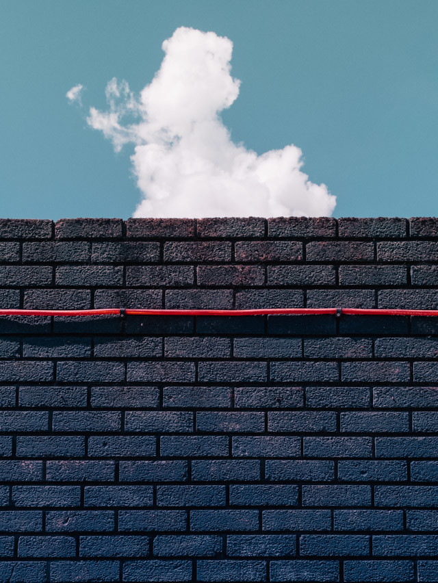 cloud peeking over wall