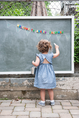 Aggie drawing on her new magnetic outdoor chalkboard
