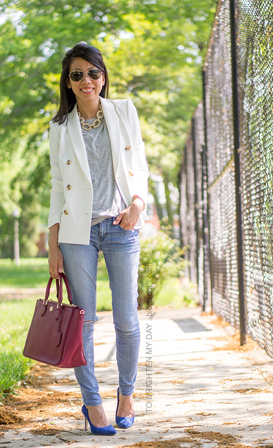 white blazer, statement necklace, gray tee, raspberry tote, blue suede pumps