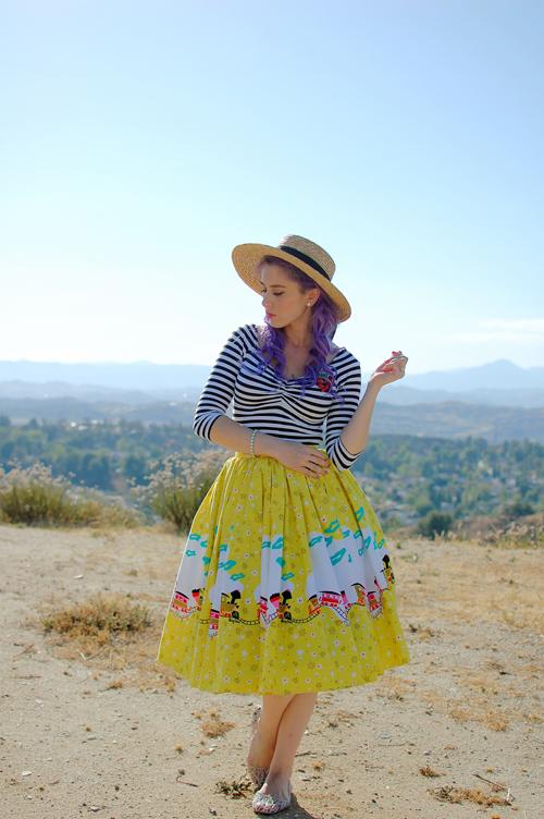 Pinup Girl Clothing Jenny skirt in Mary Blair Train Border print