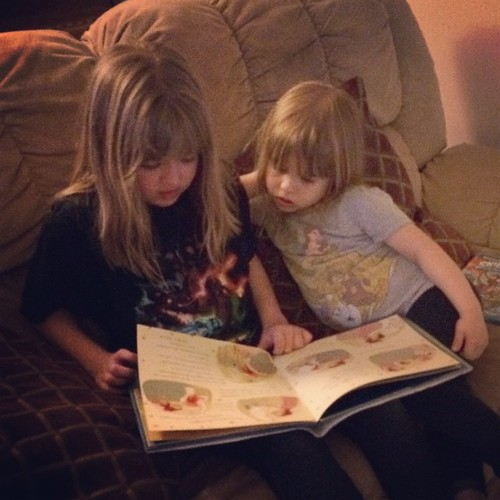 I don't think I'll ever get tired of watching Catie read to Lucy.