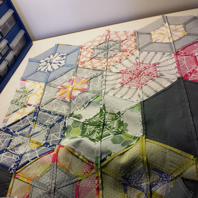 Sewing the two halves together.  Hexie quilt top fully assembled!