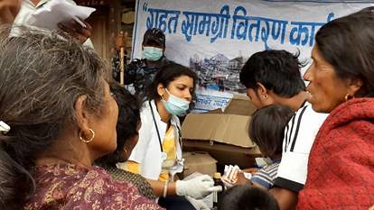 Children's Welfare Scheme handing out medical supplies in Nepal