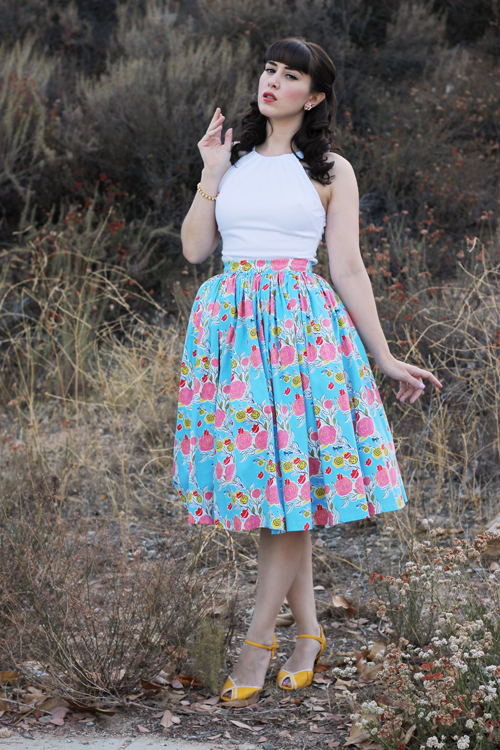 Pinup Girl Clothing Pinup Couture Jenny Skirt in Mary Blair Lips and Roses Print in Blue Harley Top in White