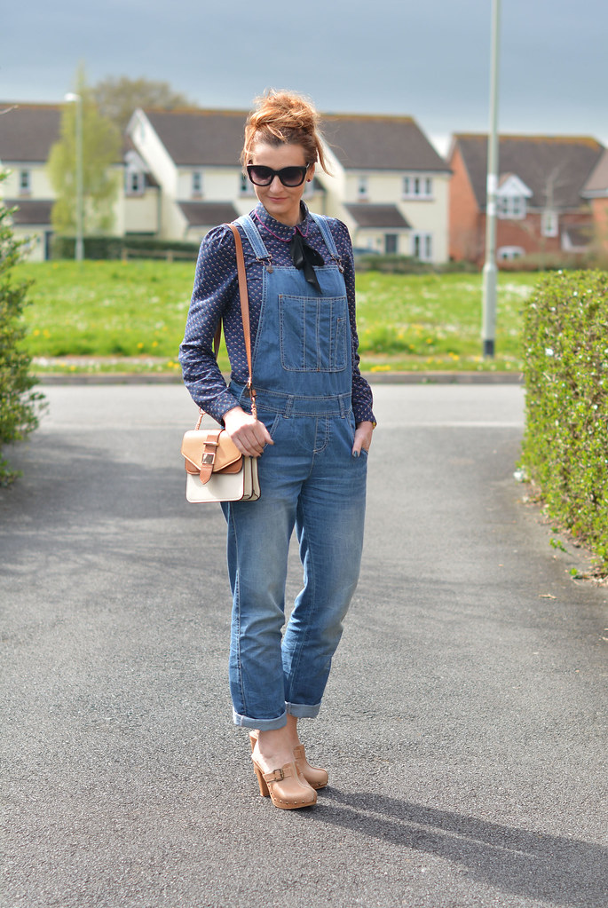 Blue denim dungarees (overalls), patterned Peter Pan collar shirt and heeled clogs