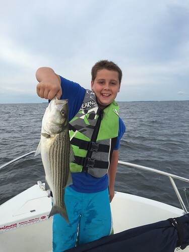 Photo of boy holding striped bass