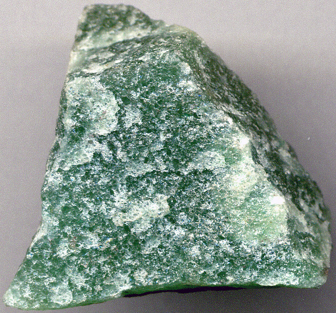 White Metamorphic Rock : Quartzite metaquartzite cm across at