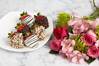 Dipped fancy strawberries from Shari's Berries coated in nuts and chocolate chips with All the Frills bouquet from ProFlowers with mums, alstroemeria Peruvian lilies and roses | by ProFlowers.com