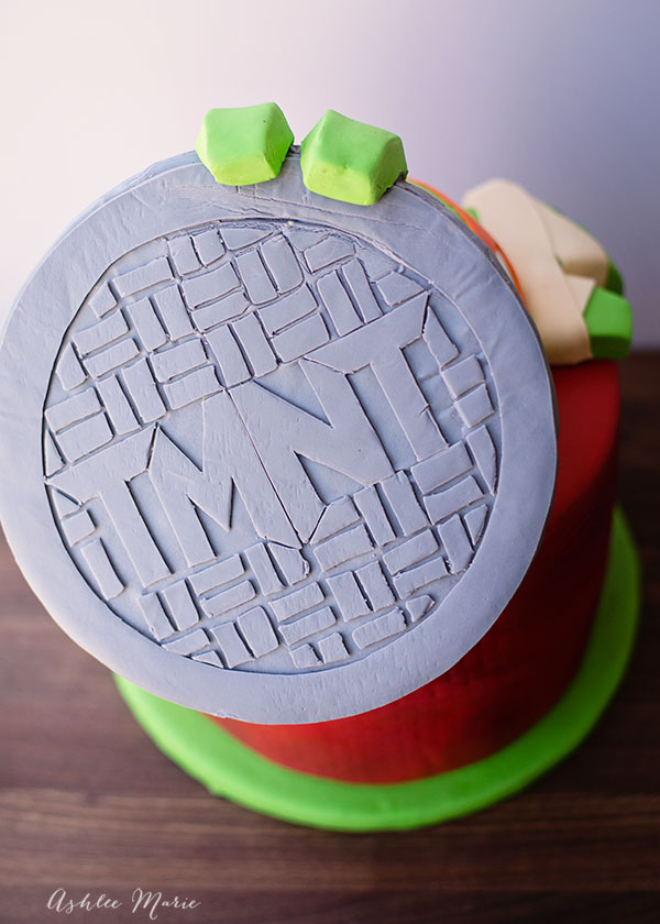 fondant manhole cover and Teenage Mutant ninja turtle birthday cake
