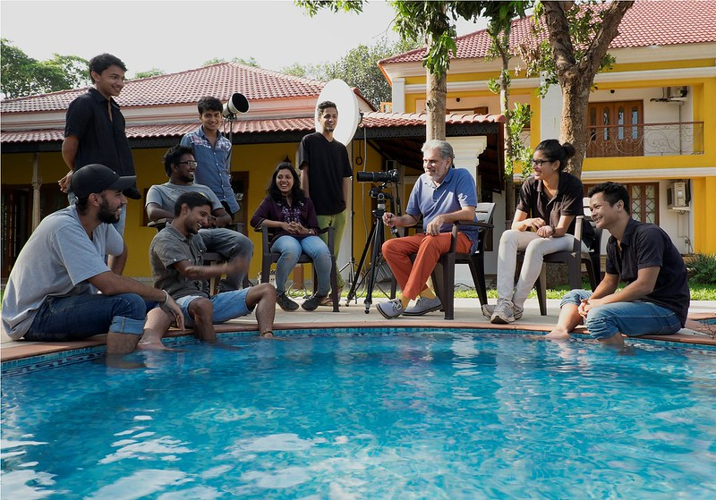 SHANTANU WITH STUDENTS at a pool side conference