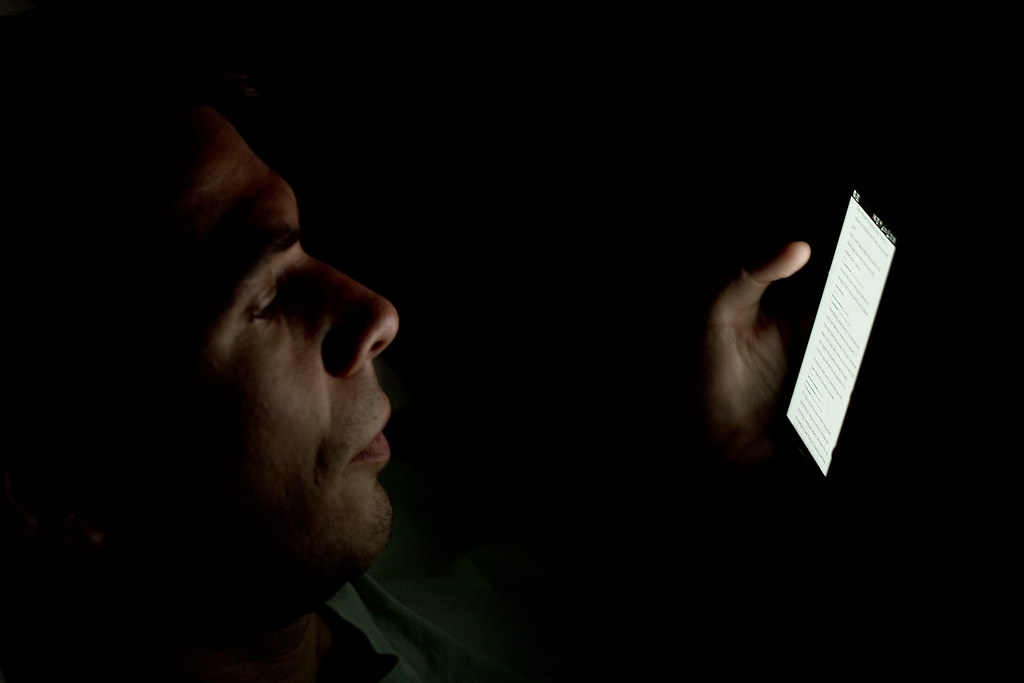 person looking at smartphone in the dark a male caucasian flickr