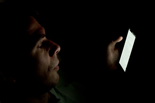 Person looking at smartphone in the dark | by Japanexperterna.se