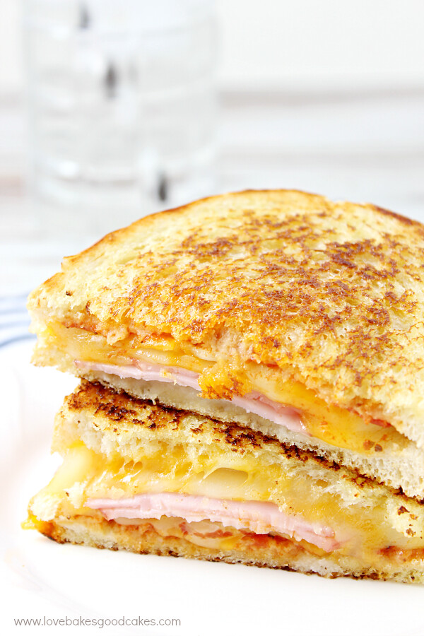 Hawaiian Pizza Grilled Cheese Sandwich stacked on a plate close up.