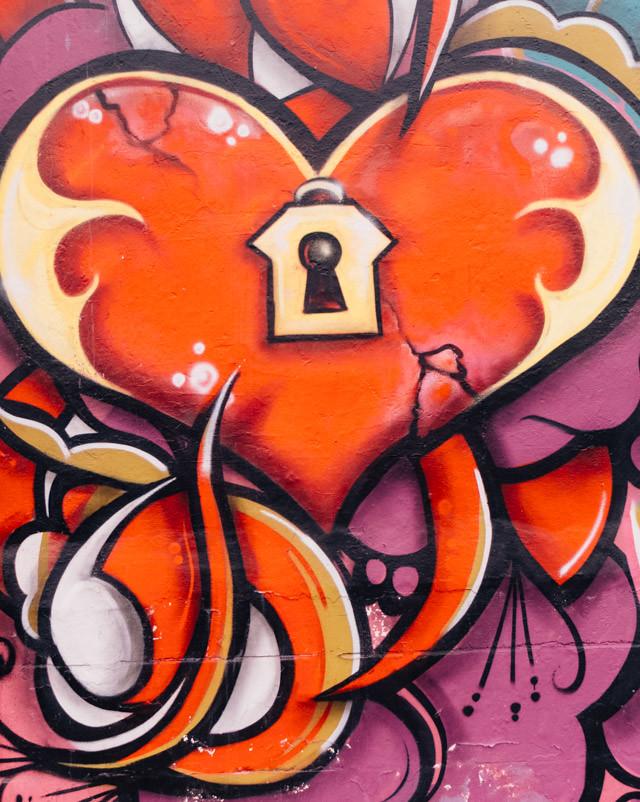 heart and lock graffiti on cardiff wall