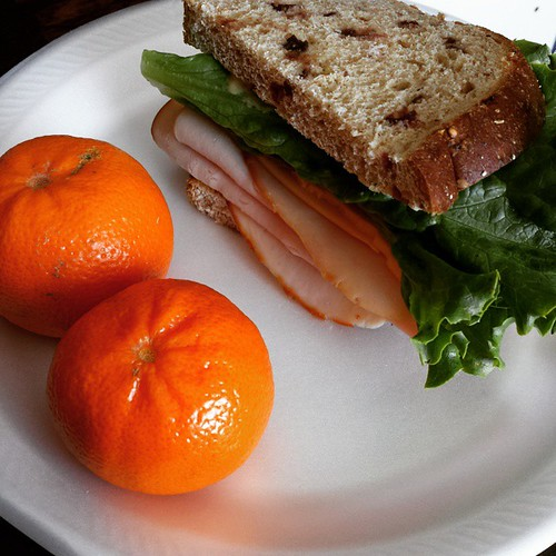 Lunch! Turkey and leaf lettuce on cranberry wheat bread, with two clementines. #Yum