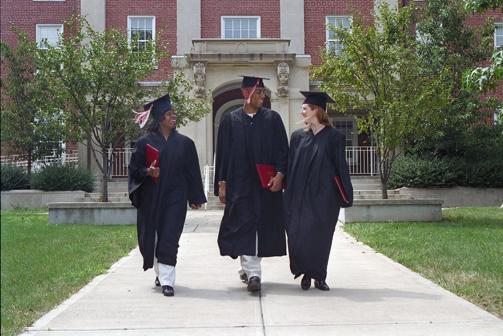 Image result for graduation cap and gown