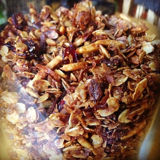 Granola success! Since this was my first time making it, I kept it pretty basic - lots of slivered almonds, some sunflower seeds, some craisins, maple syrup and honey... Slightly modified from a basic online recipe. Next time I'll try personalizing it mor