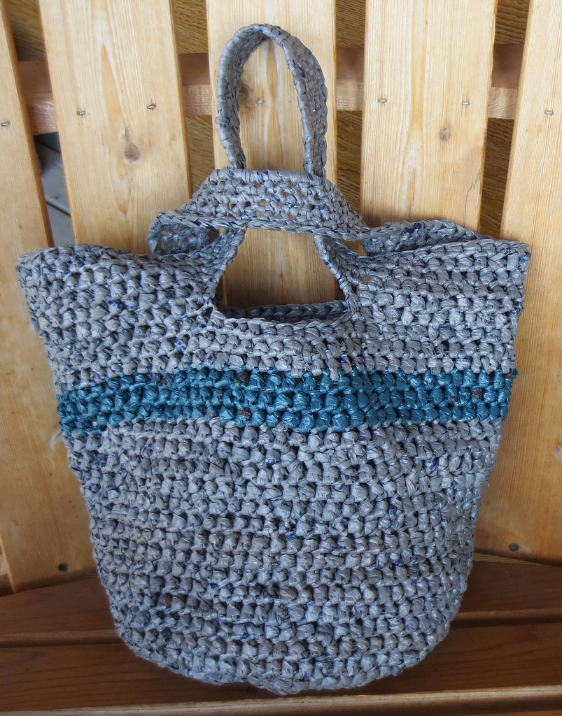 Crochet recycled plastic bags - I Used Mainly Recycled Grey Walmart Plastic Bags To Crochet The Tote Bag With 4 Blue Plastic Bags For The Stripe It Took About 50 Plastic Bags Cut 1 Inch