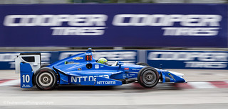 Tony Kanaan gets some air | by Paul Henman
