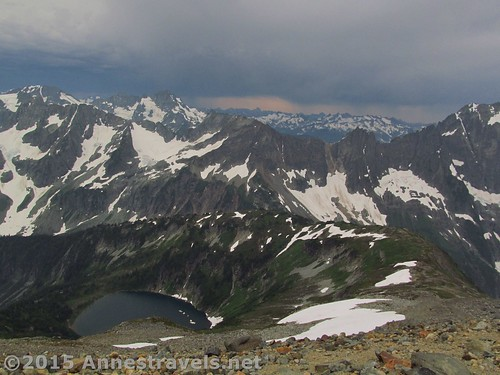 Part of the view from the top, just below Sahale Glacier. From L to R are Spider Mountain, Magic Mountain, Doubtful Lake, Mount Formidable, Mix-up Mountain, The Triplets, Sahale Arm, and Cascade Peak. Yes, you've climbed up all of that arm! North Cascades National Park, Washington