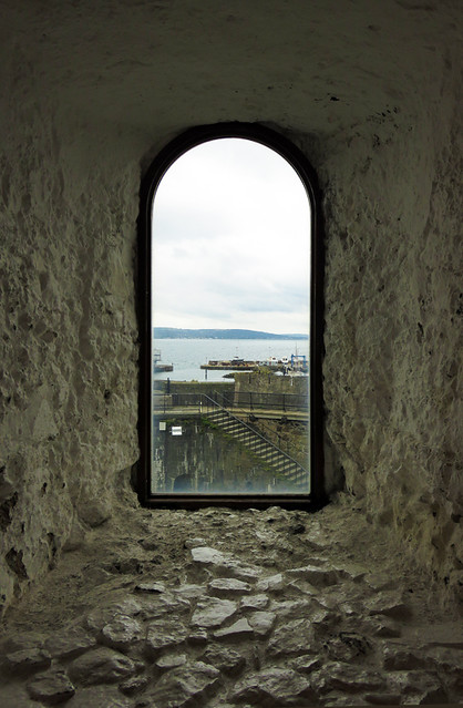 A window looking out to the sea in the medieval castle of Carrickfergus along the Coastal Causeway Route of Ireland, UK