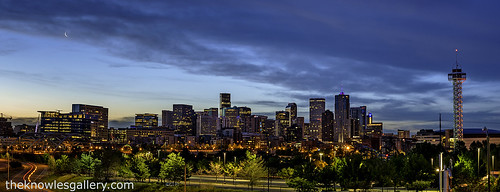 City lights of Denver with a crescent moon | by The Knowles Gallery