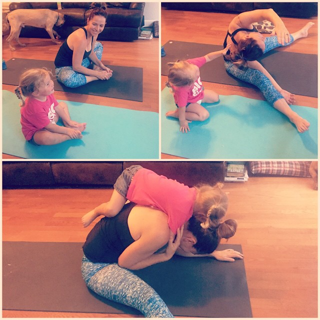 "It's always nice to have a yoga partner who will assist you with your form (""NO MOMMY DO IT LIKE ME, OPEN YOU KNEES!"") and help deepen your hip opener with some gentle (ahem) adjustments."