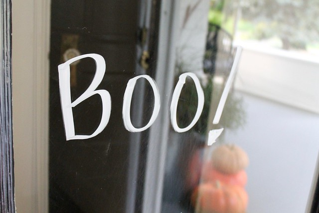 Boo! in Sharpie on Glass Front Door.