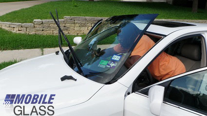 Mobile windshield replacement; removing broken windshield by Austin Mobile Glass Technician