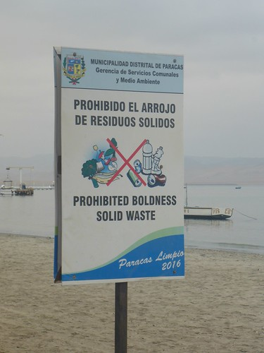 "A ""prohibited solid boldness waste"" sign""..."