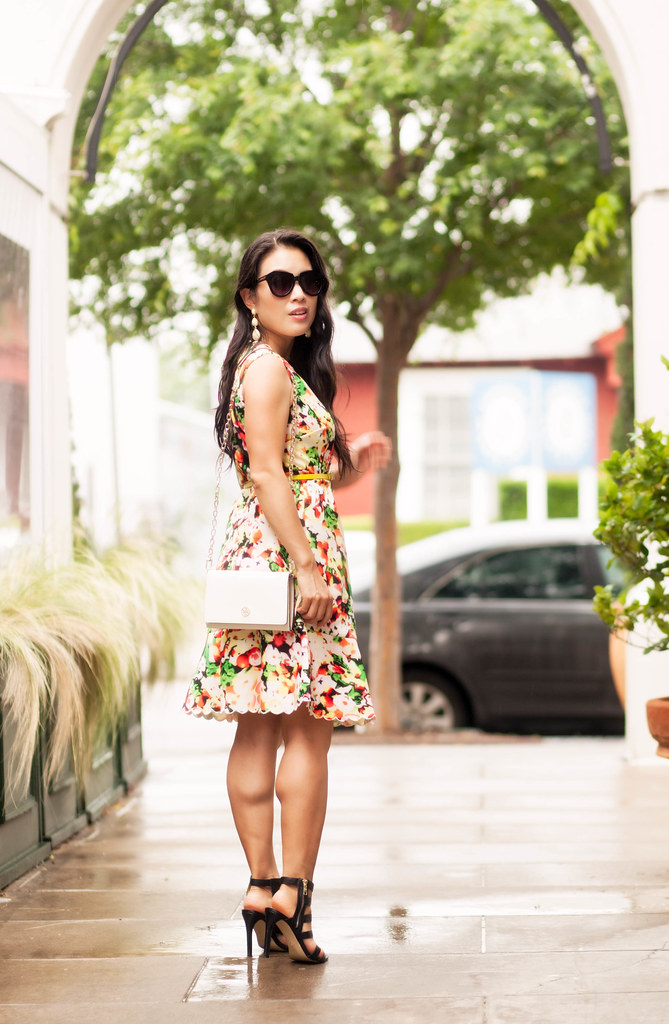 cute & little blog | floral drop waist flounce dress, yellow bow belt, ann taylor rosie gladiator sandals, tory burch robinson wallet on chain | spring summer outfit