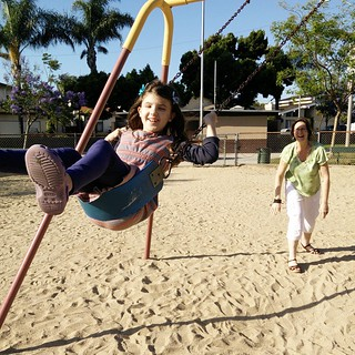 The best things in life are free! I love the look on my mom's face as she pushes my girls on the swings... :-) | by Urthmama