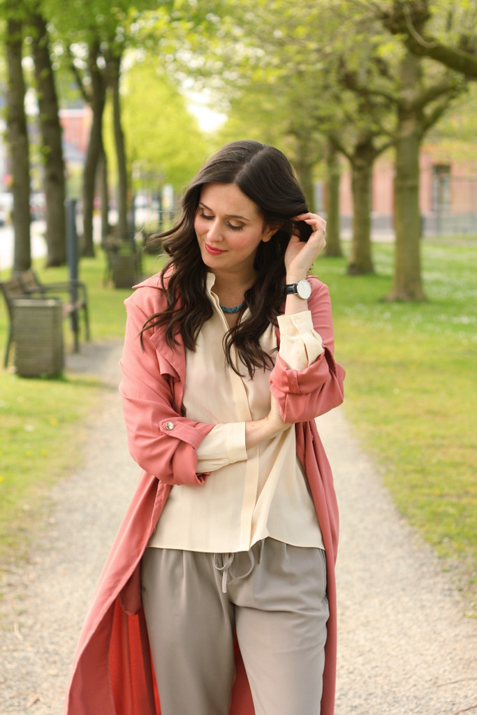 outfit: pink duster coat, silk blouse, loose trousers