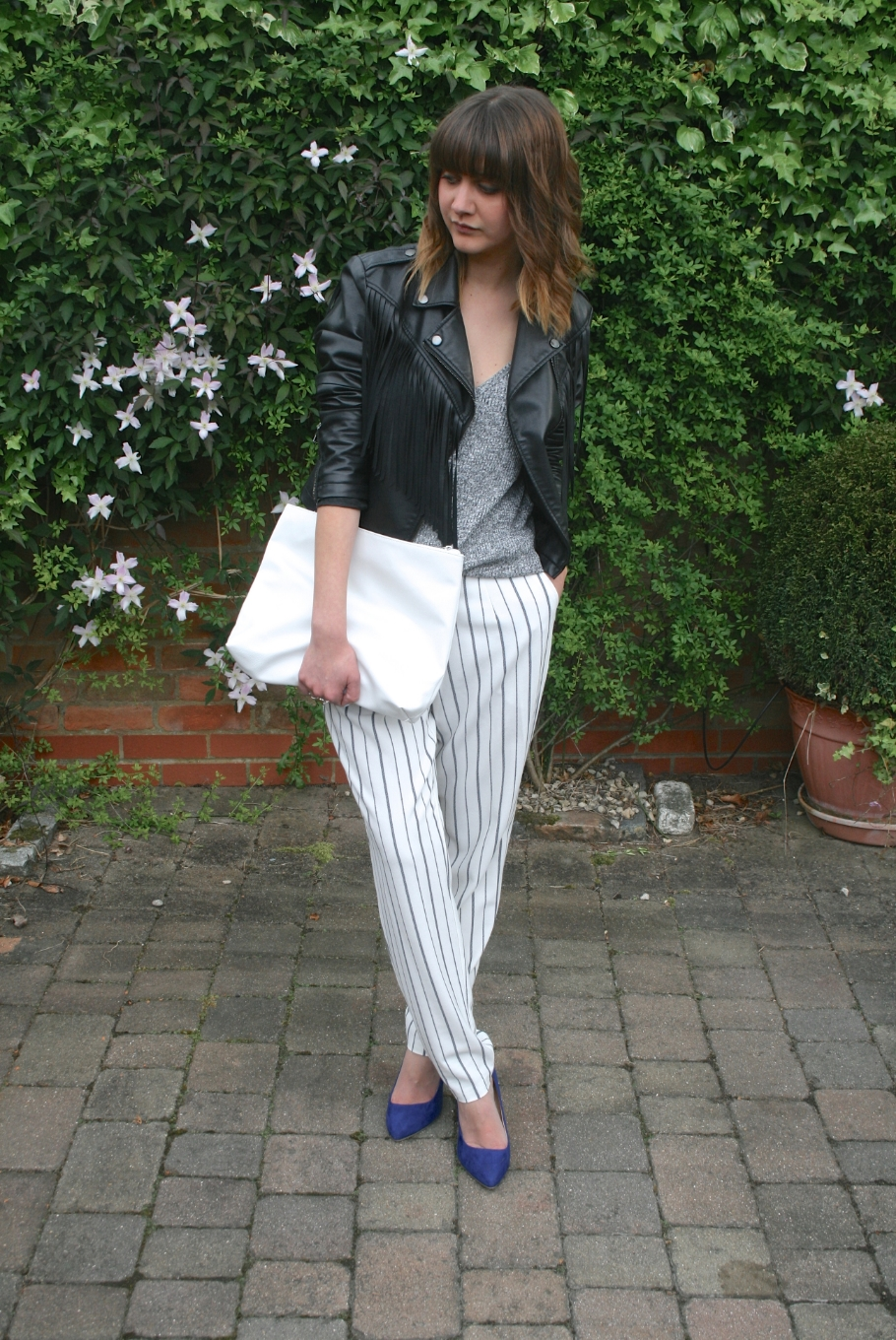 leather jacket and striped trousers